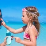 9 Most Commonly Missed Sunscreen Spots, According To Dermatologists